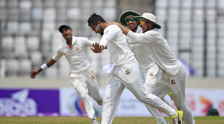 Teammates congratulate Bangladesh's Sakib Al Hasan, second left, after the dismissal of Australia's Glenn Maxwell during the fourth day of their first test cricket match in Dhaka, Bangladesh, Wednesday, Aug. 30, 2017. (AP Photo/A.M. Ahad)